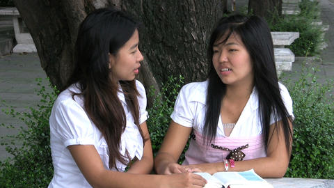 Two Asian Girls Talking And Praying Stock Video Footage