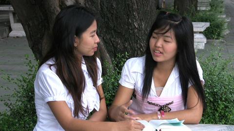 Two Asian Girls Talking And Praying Stock Video Footage