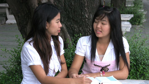 Two Asian Girls Talking And Praying stock footage