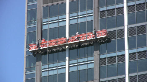 Window Repairmen Working On Office Building Footage