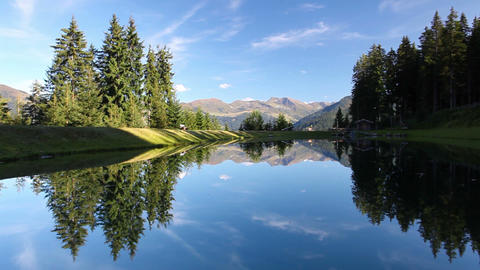 The lake on the top above alpine village of Alpbach Footage