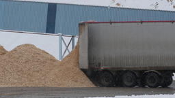 Wood chips being unloaded from truck at paper mill Footage