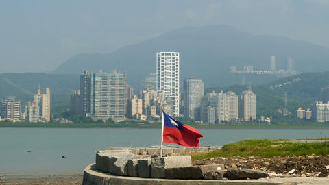 Skyline of Tamsui with Taiwan flag in front Live Action