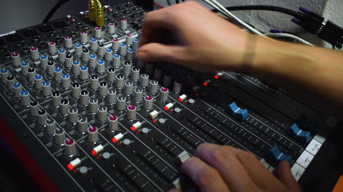 man uses the sound mixer Live Action
