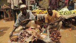 Niger, Africa. July 2013. Portrait of african street market sellers Footage