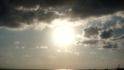 Gloomy sunshine to sunset and moving clouds - time lapse Footage
