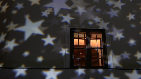 White stars that are projected on the wall of a house where the lights can be se Footage