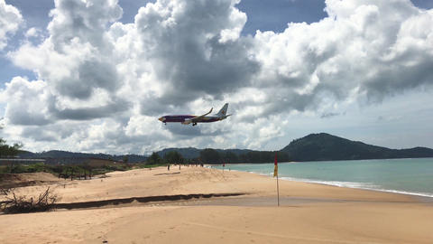 Beach Sea With Airplane Landing Footage