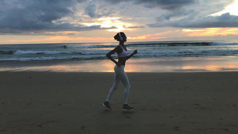 Sporty Female Running On The Beach Footage