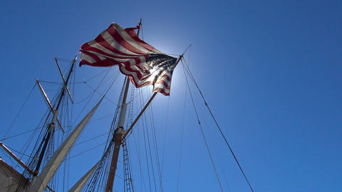 American flag on a sailing frigate. San Diego. California Footage