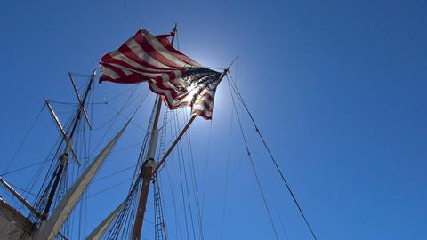 American flag on a sailing frigate. San Diego. California Footage