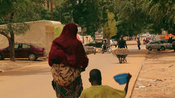 Niger, Africa. July 2013. Street scene with cars and motorcycles passing by Footage