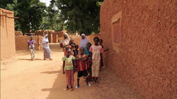 Niger, Africa. July 2013. Wide shot of women with their kids at village Footage