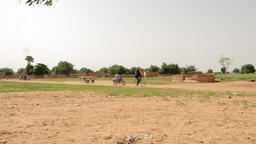 Niger,Africa. July 2013.Carriages, bicycles and motorcycles passsing Footage