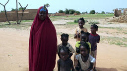 Niger, Africa. July 2013. African woman with children in a village by the countr Footage