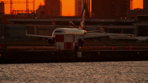 London City Airport - British Airways Boeing landing during sunset Footage