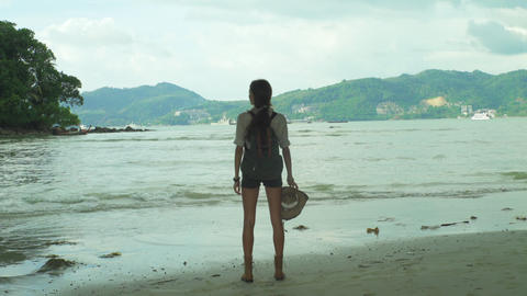 Girl With A Backpack Standing In Front Of A Ocean Footage
