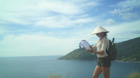 Female Tourist Reading Map At The Top Of The Hill Footage