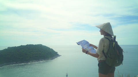 Traveler Girl Holding Map With Travel Destinations Footage