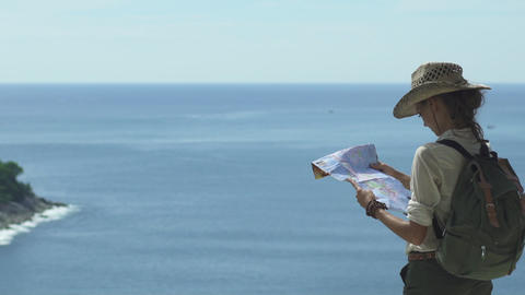 Woman Looking At The Map On A Tropical Landscape Footage
