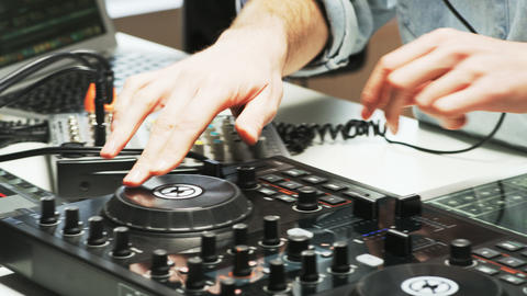 Disc Jockey's Hands While He Changes Settings of the Sound Control System Footage