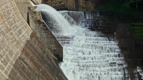 Waterfall Flows out of Concrete Dam along Cascade Steps Footage