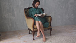 Beautiful woman reading a book Footage