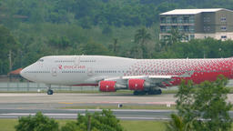 Boeing 747 of Rossiya airlines drives on airport taxiway Footage