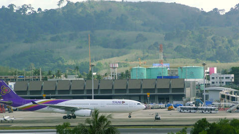 Airplane of Thai Airlines rides on taxiway Footage