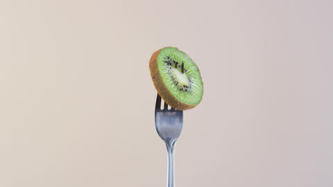 Fork With Kiwi on Almond Background Footage