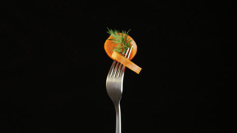 Fork With Carrot on Black Background Footage