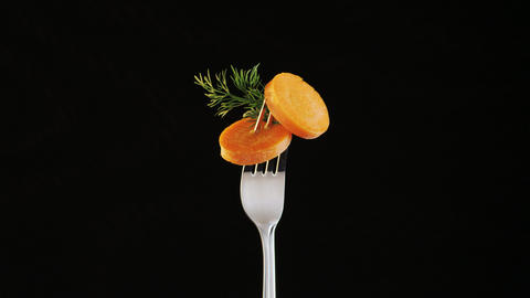 Fork With Carrot on Black Background ビデオ