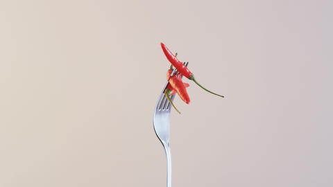 Fork With Three Chili Peppers on Almond Background ビデオ