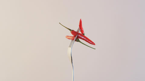 Fork With Three Chili Peppers on Almond Background Stock Video Footage