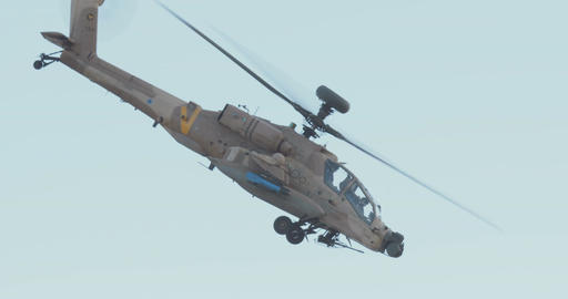 Military helicopter performing combat maneuvers during an airshow Archivo