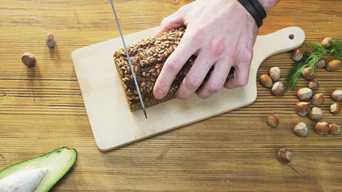 Slicing Loaves of Wholegrain Bread Footage