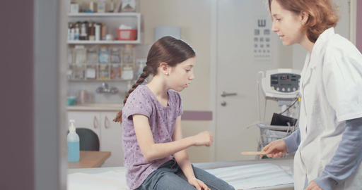 Female doctor checking a young girl in the hospital Footage