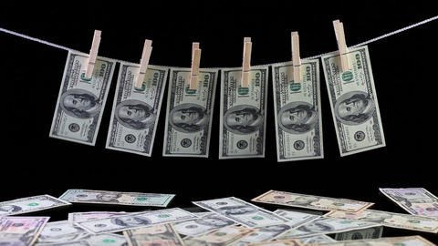Dirty US dollar banknotes hanging from a clothesline Footage