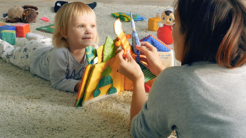 Mother shows puppet theatre to her daughter Footage