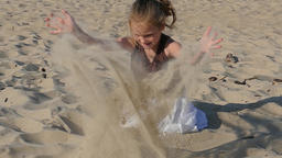 Girl is enjoying her holidays by the sea. Sandy beach. Slow motion Footage