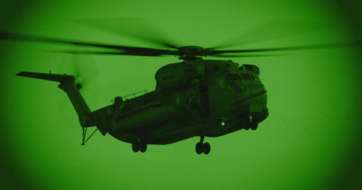 Night vision footage of army helicopter during combat mission Footage