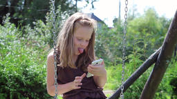 Young girl is making funny faces to her smartphone's camera Footage