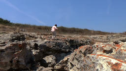 Lady model walking on the edge of sea cliffs kaliakra yaylata bulgaria Footage