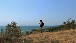 Lady model walking on the edge of sea cliffs kaliakra yaylata bulgaria Footage