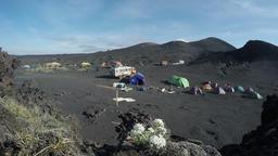 Summer touristic tent camp on slag field on Tolbachik Dale. Kamchatka Peninsula Footage