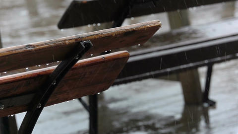 Empty Bench in a Street Cafe and Rain. Slow Motion Footage