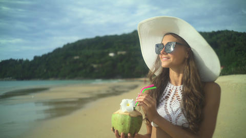 Girl Holding Fresh Cold Coconut At Tropical Beach Footage
