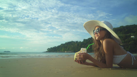 Young Woman In Bikini Drink Cocktail On Beach Footage