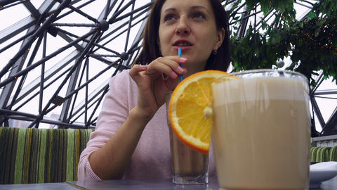 Beautiful young girl drinks cacao Footage
