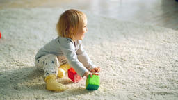 Little girl plays with toy blocks Footage